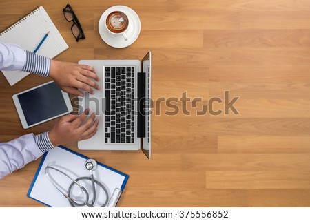 Professional doctor use computer and medical equipment all around, desktop top view with copyspace, coffee - stock photo