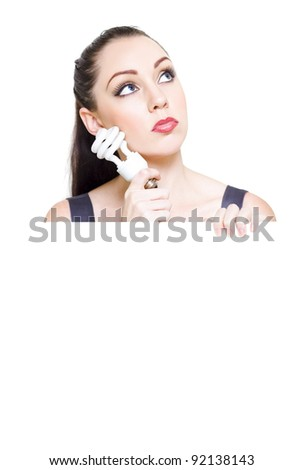Professional Female Holding An Energy Efficient Lightbulb Looking Up In A Sign Of Expansion And Innovation When Seeking Future Business Growth And Development - stock photo