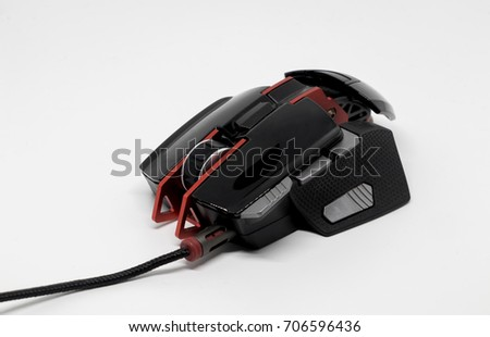 Professional gamers black laser computer mouse isolated on white background.