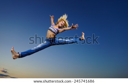 Professional gymnast woman at night - stock photo