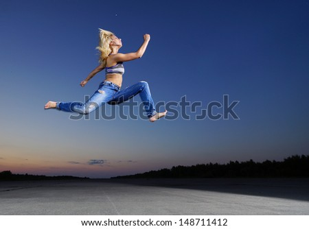 Professional gymnast woman jump at night