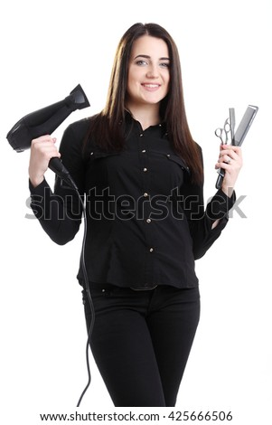 professional hair stylist holding blow dryer and hairdressing tools