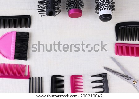 Professional hairdresser tools  on color wooden background - stock photo