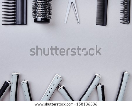 Professional hairdresser tools on gray background - stock photo