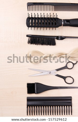Professional hairdresser tools on table close-up - stock photo