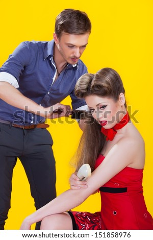 Professional hairdresser with long hair model - stock photo