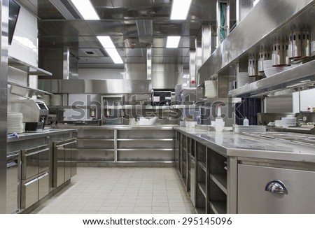 Professional kitchen , view counter in stainless steel . Bokeh . - stock photo