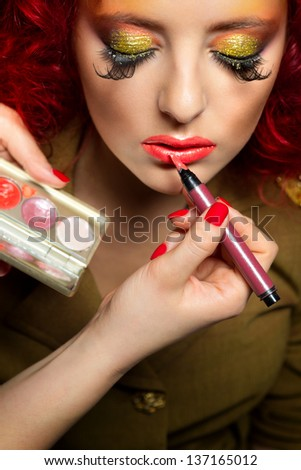 Professional Make-up,  artist doing glamour model makeup at work - stock photo
