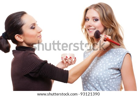 professional make-up artist doing make-up with brush. isolated on white background - stock photo