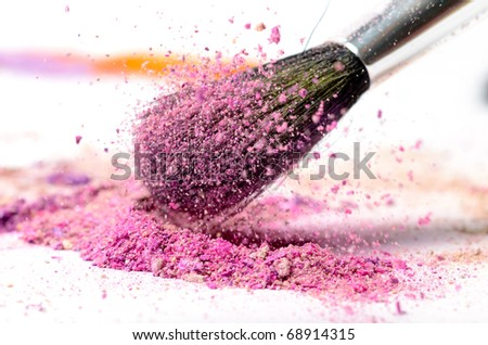 professional make-up brush on colorful crushed eyeshadow - stock photo