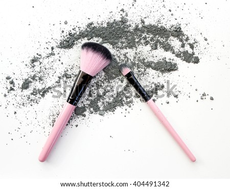 professional make-up brush with dust eyeshadow colorful - stock photo