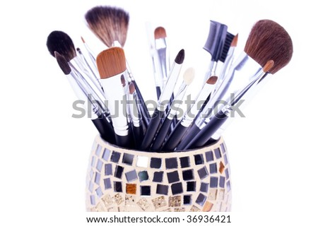 Professional make-up brushes in mirror can - stock photo
