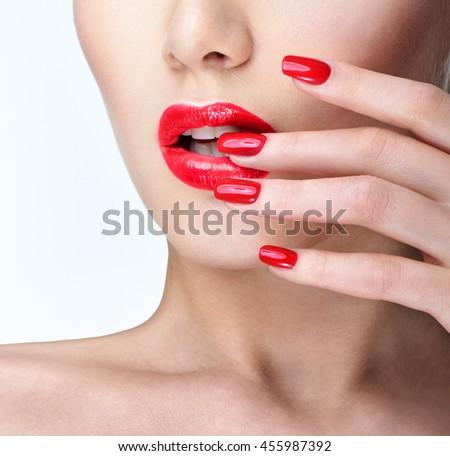 Professional Makeup.   Beautiful Fashion Model Girl Face. Perfect manicure.  Red Lipstick. - stock photo