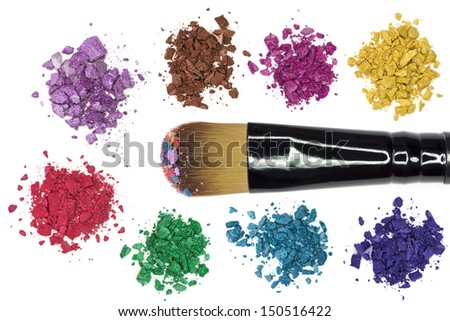 Professional makeup brush with colorful makeup powder and crushed eyeshadow