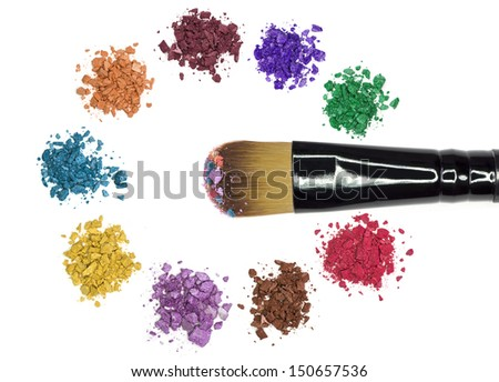Professional makeup brush with colorful makeup powder and crushed eyeshadow - stock photo