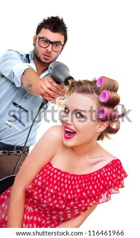 Professional male hairdresser, isolated on white - stock photo