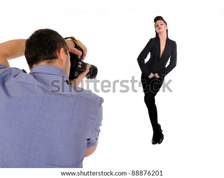 professional male photographer at studio fashion shot with a model. isolated