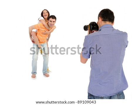 professional male photographer making family picture at studio. isolated - stock photo