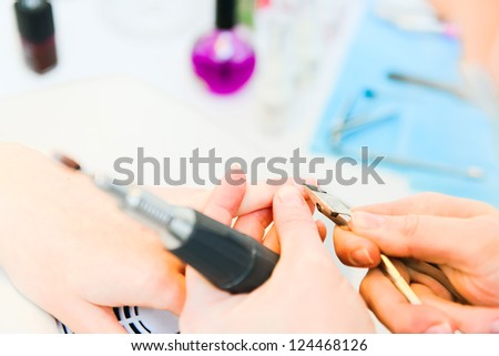 Professional manicure in process