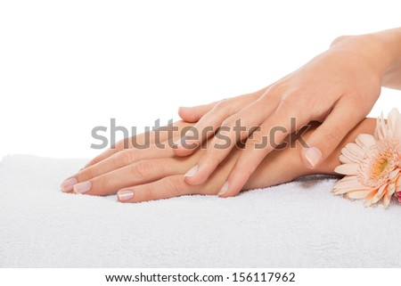 professional manicurist doing a manicure natural look  - stock photo