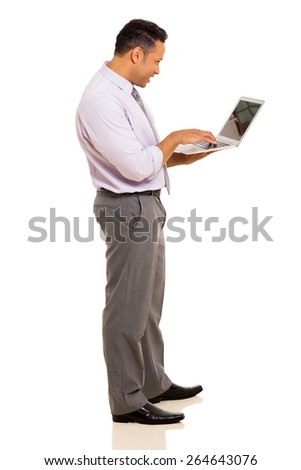 professional mature businessman using laptop on white background - stock photo