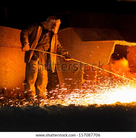 professional metallurgist controls before the release of iron smelting - stock photo