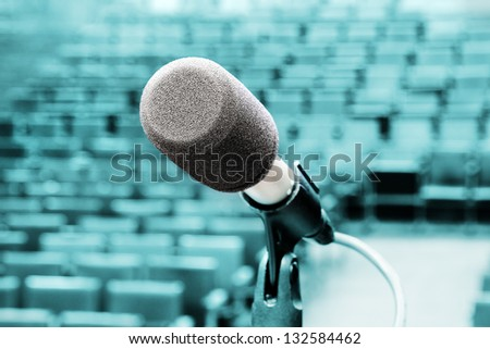 Professional microphone against concert hall - stock photo