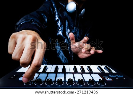professional musician or DJ hands playing studio keyboard synthesizer, isolated on black for dance , groove, remix, underground background - stock photo