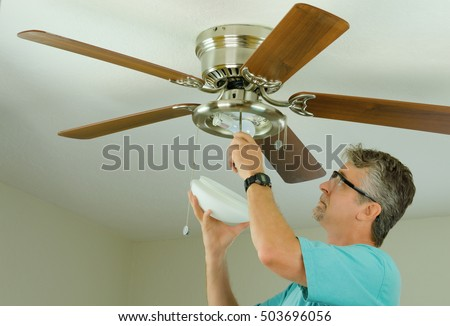 Ceiling fan stock images royalty free images vectors shutterstock professional or diy do it yourself home owner doing ceiling fan repair work with aloadofball Gallery