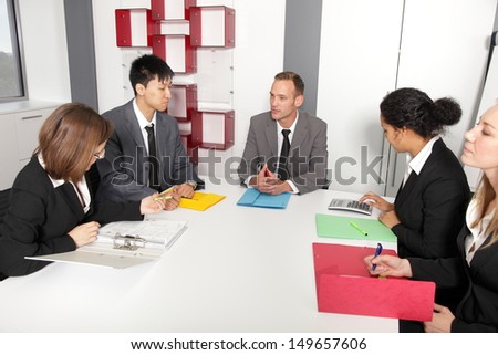 Professional people together exchanging ideas in the conference room - stock photo