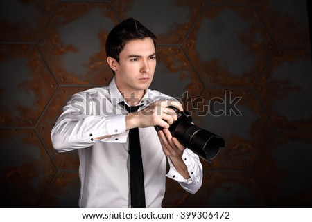 Professional photographer is looking at the object