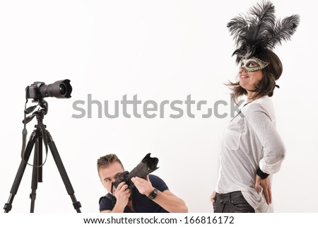 Professional photographer taking shoots with a telephoto lens - stock photo