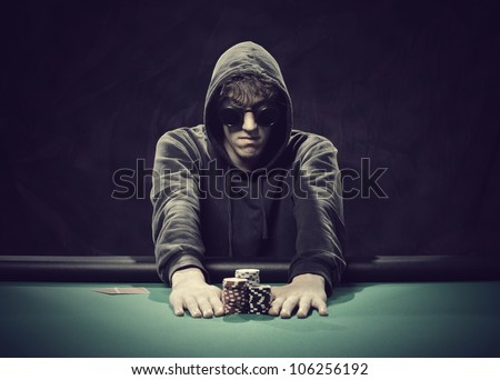 Professional poker player betting everything on one hand - stock photo