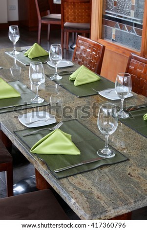 professional restaurant serving: table setting in luxury european restaurant, interior  - stock photo