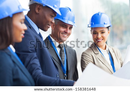 professional senior construction manager working with team