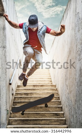 Professional skateboarder boy jumps off the stairs - stock photo