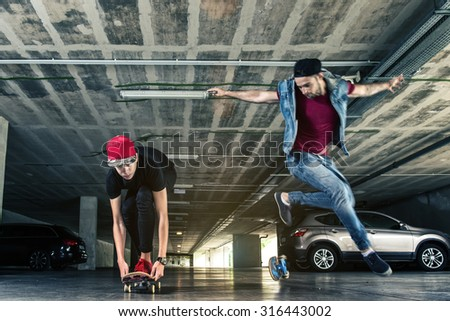 Professional skateboarder jumps in the subway - stock photo