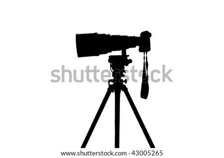 Professional sports photographer camera silhouette - stock photo