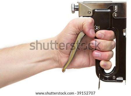 Professional staple gun in the hand isolated over white background - stock photo