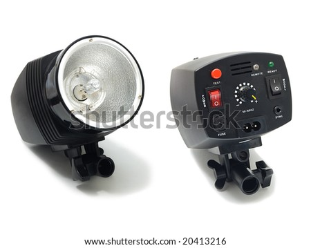 Professional studio strobe, front and back side, isolated on the white - stock photo