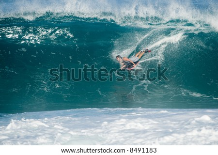 professional surfer at a contest (for editorial use only)