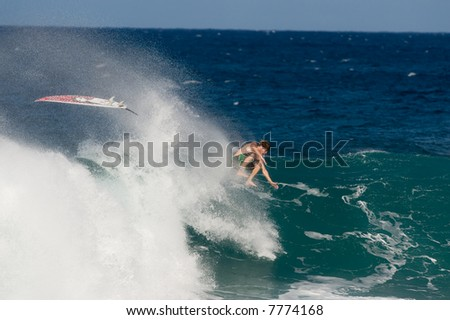 professional surfer wipeout (for editorial use only)