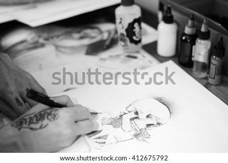 Professional tattoo master prepares for work. sit at the table & draw