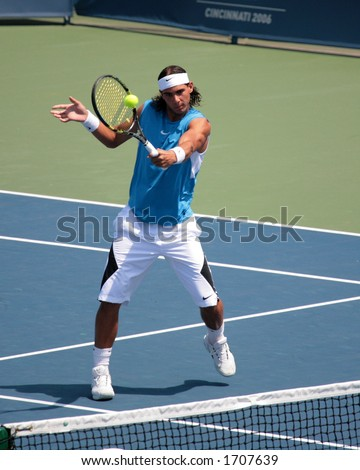 Professional Tennis Player Rafael Nadal hitting a volley - stock photo