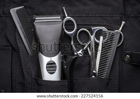 professional tools of hairdresser in black case - stock photo