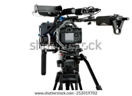Professional video camera on the white background - stock photo
