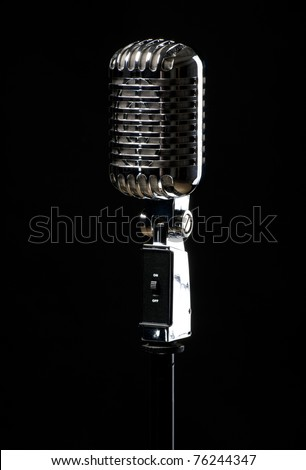 Professional vintage microphone isolated on black background - stock photo