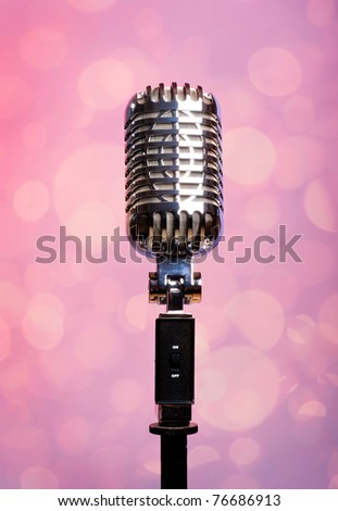Professional vintage microphone over abstract background - stock photo
