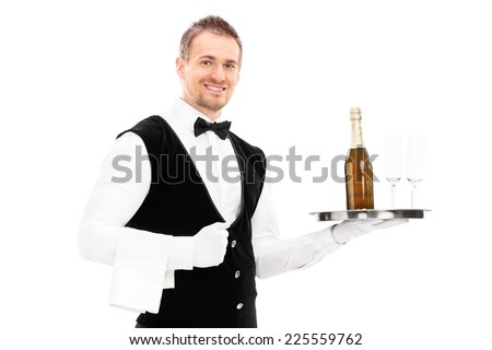 Professional waiter holding a tray with a champagne and two glasses on it isolated on white background - stock photo