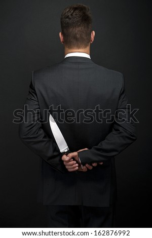 Professional waiter with knife in hand - stock photo